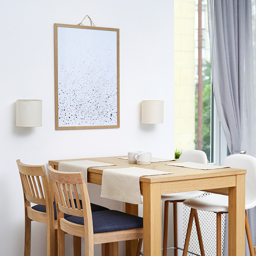A small dining table with two different style chairs in this white dining room is modern dining room ideas