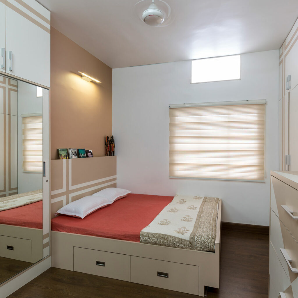 A mirrored bedroom wardrobe with a window and photo frames which includes bedroom wardrobe designs photos