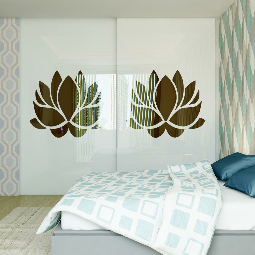 Modern sliding wardrobes has patterned wallpaper, styled wardrobe sliding doors and geometric bedspread
