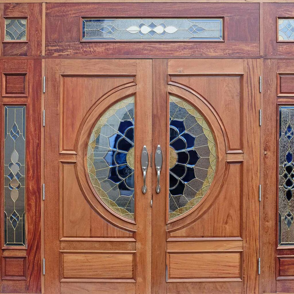 Wooden carved decorated temple doors which indicates a good example of wooden mandir design for home