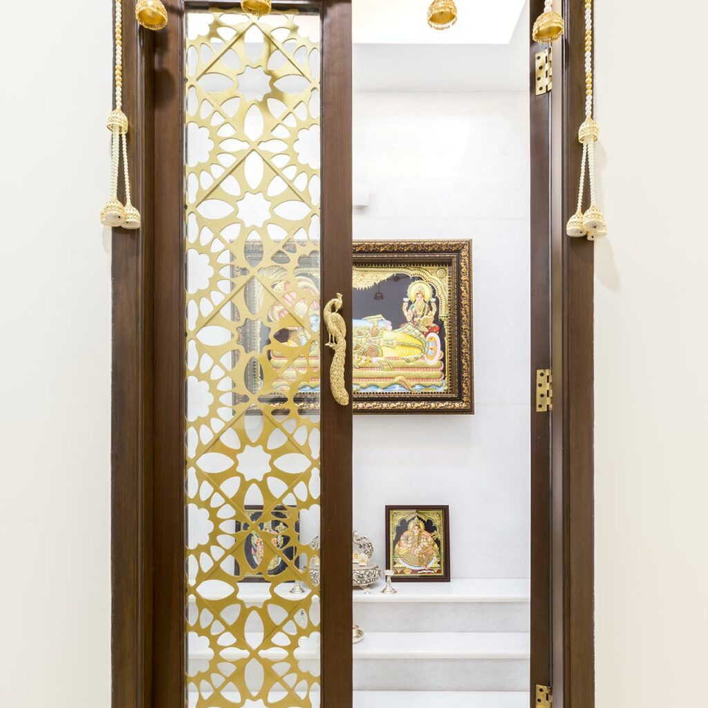 Wooden mandir cupboard which is a perfect combination of utility and look like a wooden mandir design for home