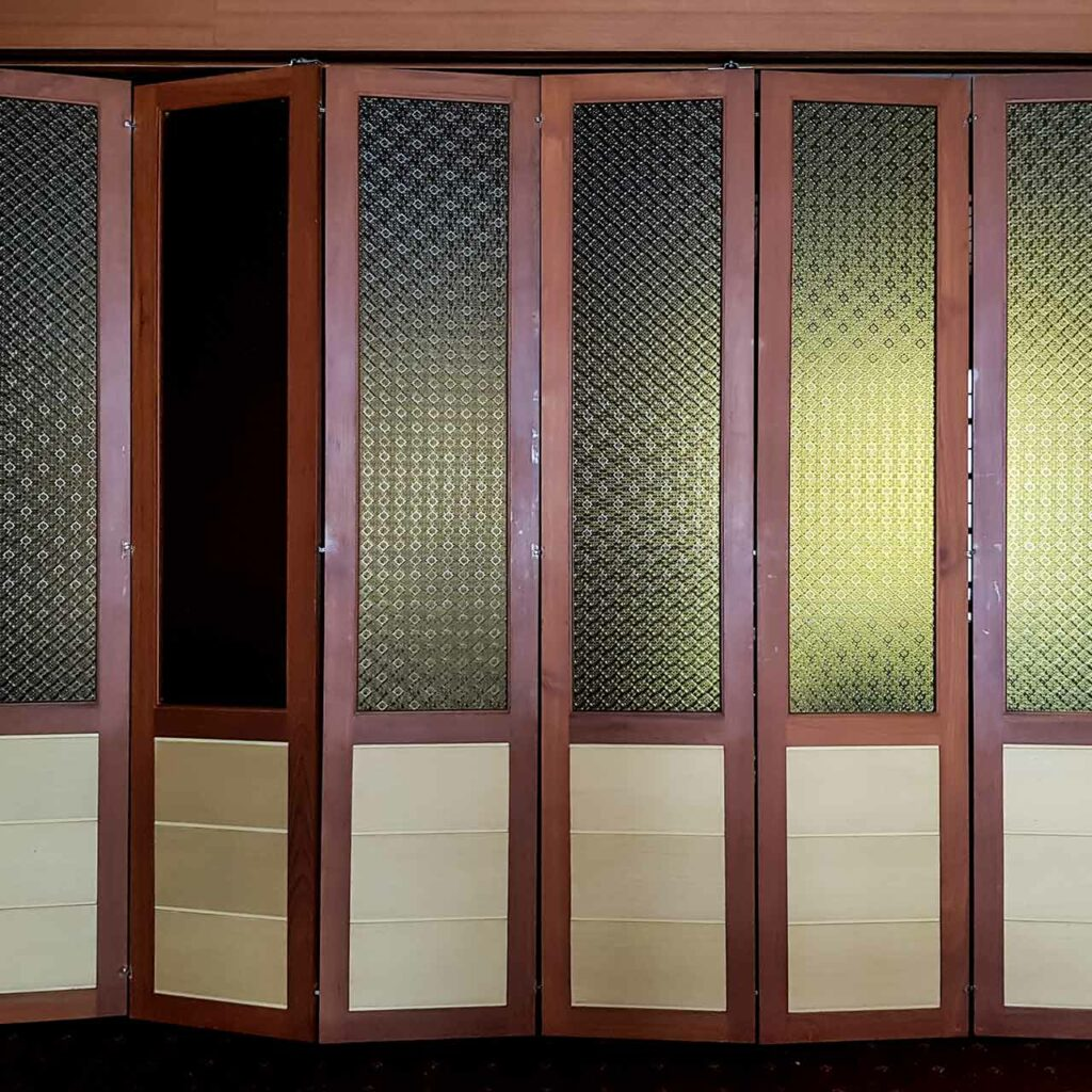 Pooja room single door designs made up of wood and a style of traditional folding