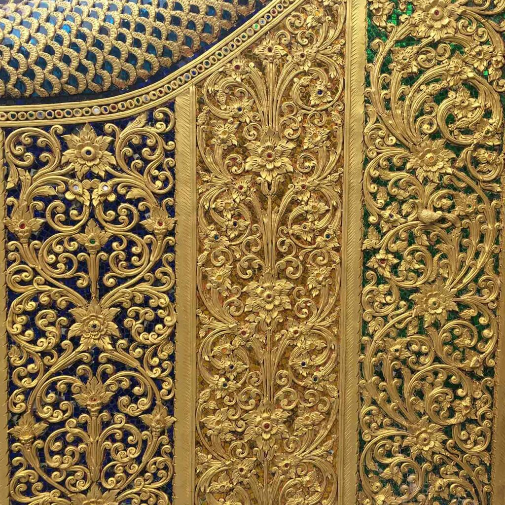 Modern pooja room door designs in wood with laser cut thai designs where the wooden door is painted white