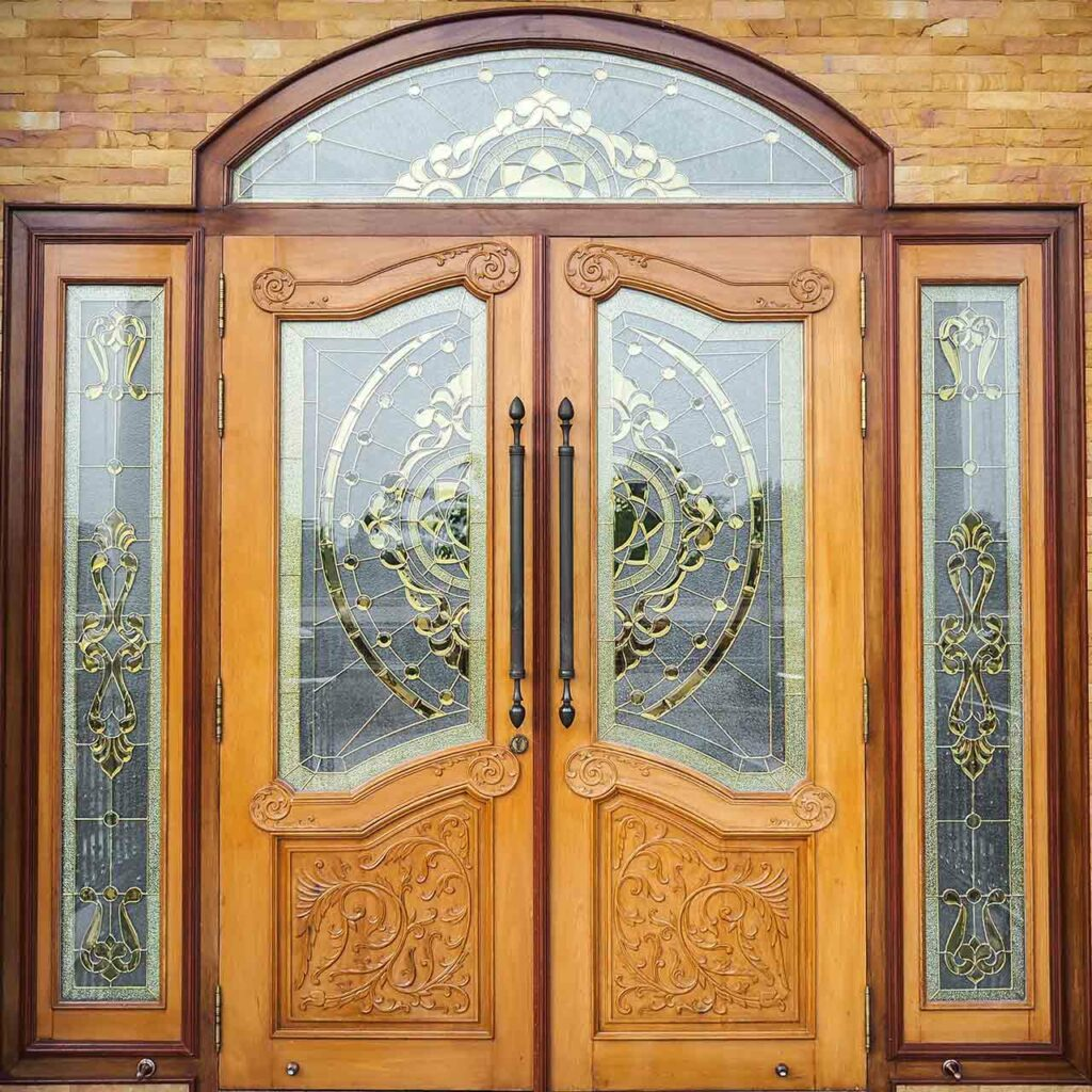 Modern pooja room door design with glass which gives a classic feel of the modern and traditional at the same time