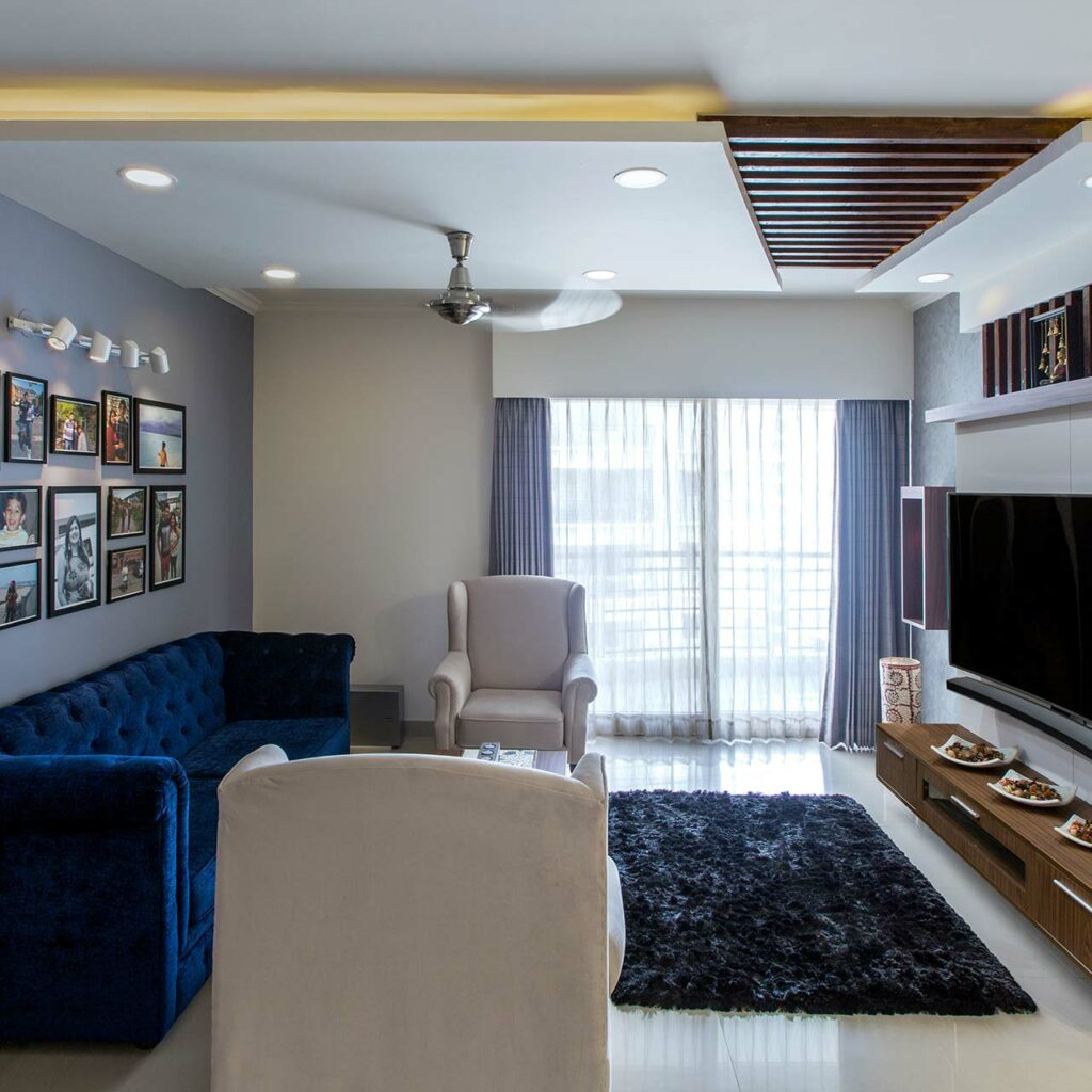 Top Furniture trends and styles of 2019 - Cobalt blue sofas contrast well with stalk white flooring and matching single seaters