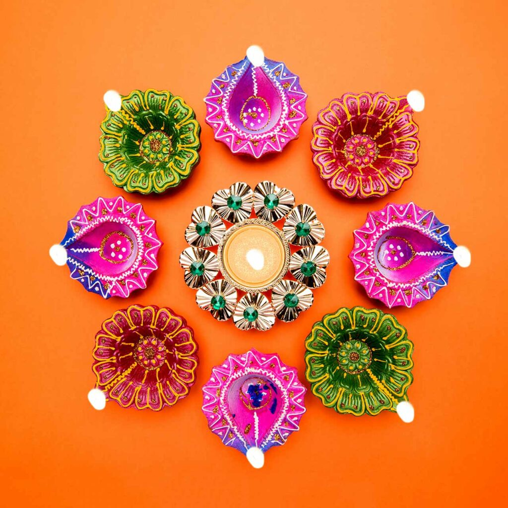 Paint your diyas with different patterns and colours for a colourful DIY look.