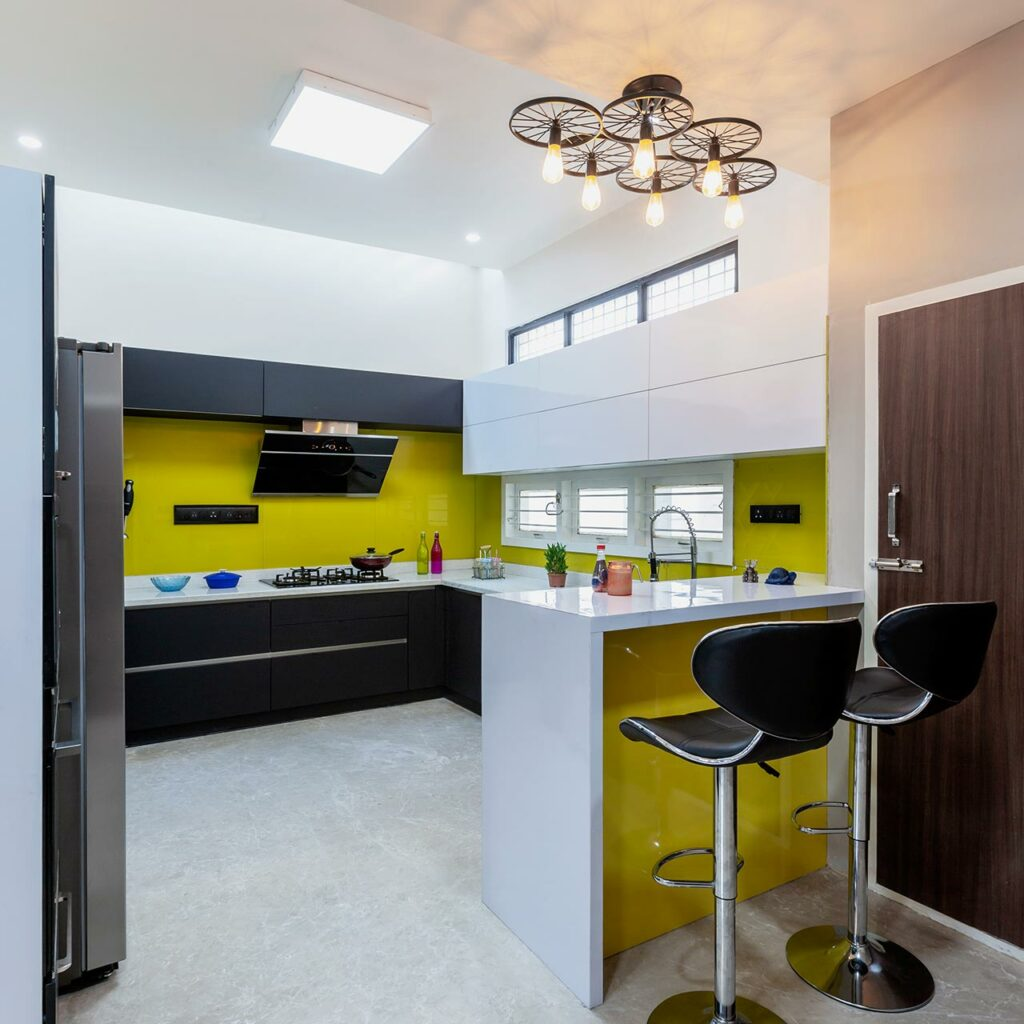 Mini kitchen design ideas with outward-facing kitchen counter with a breakfast makes more space