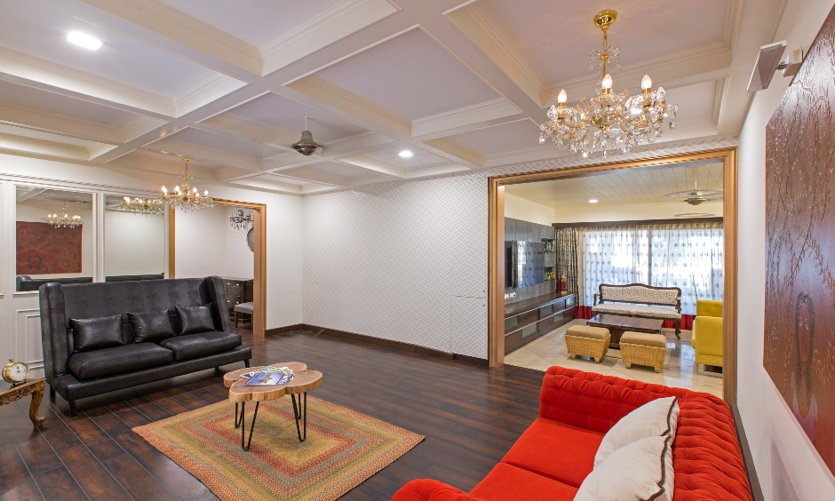 Drawing room interior design showing down false ceiling design for drawing room with chandelier to add contemporary look