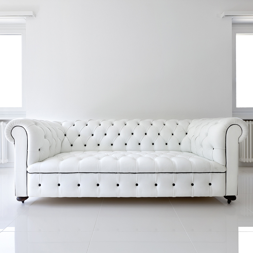 Sofa designs for small living room with a big white sofa which can fit 5 people easily in sofa ideas for small living room