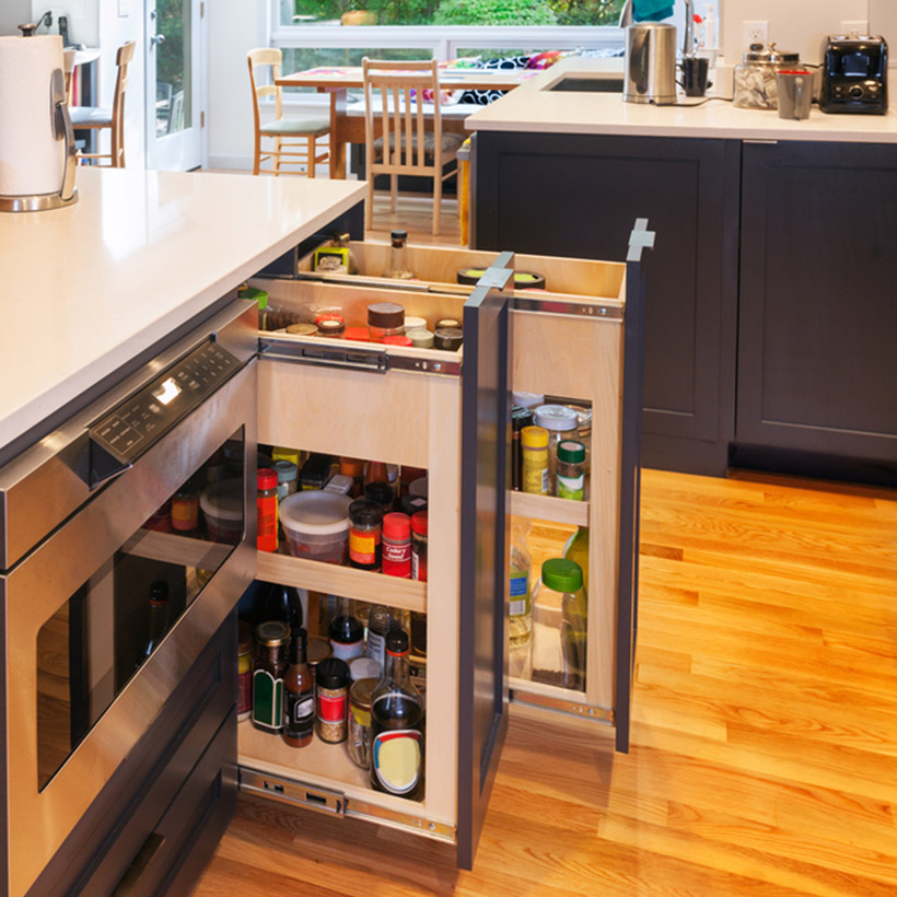 Pull-out drawers storing bottled ingredients are a great storage hack
