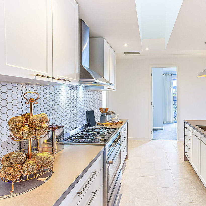 Kitchen wall tiles design of white colour with a texture of beehive in the backsplash and large yellow tiles on the floor of kitchen tiles images