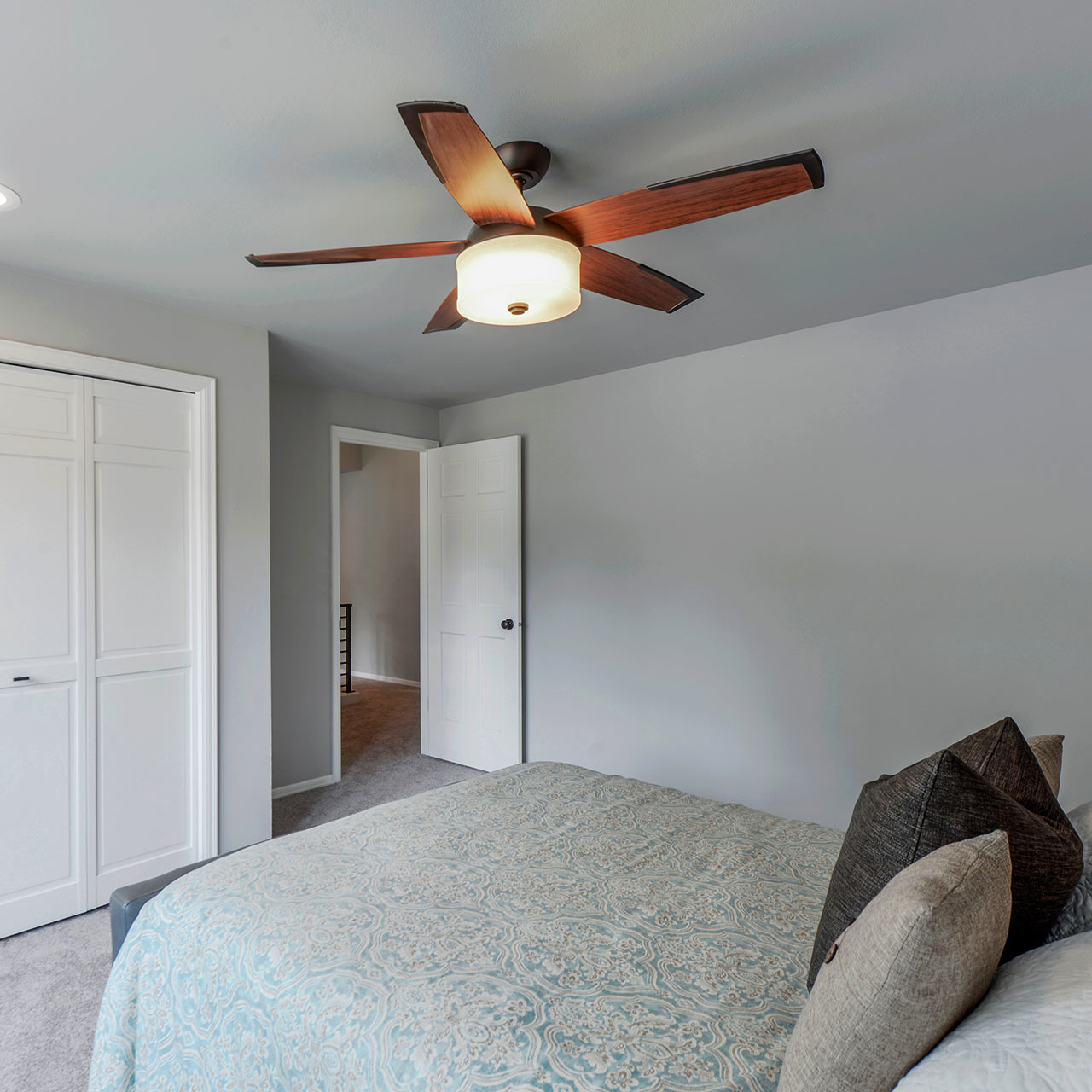 Simple bedroom interior design with a ornamental ceiling fans and hi-tech silent fan designs