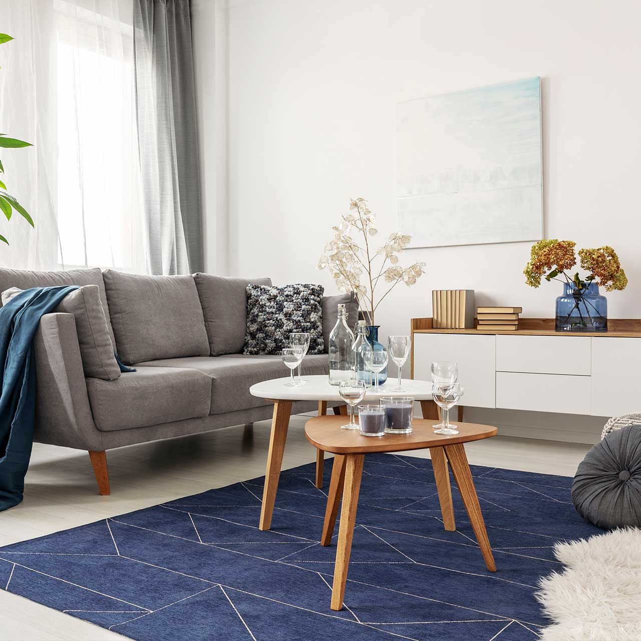 Select beautiful rugs bring in colour giving your living room interior decor
