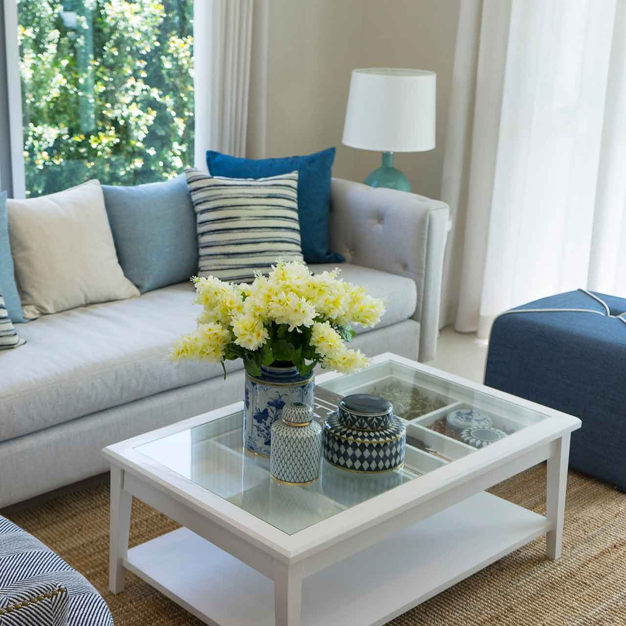 Use sand-coloured fabrics and driftwood accents to complement the beach style living room interiors