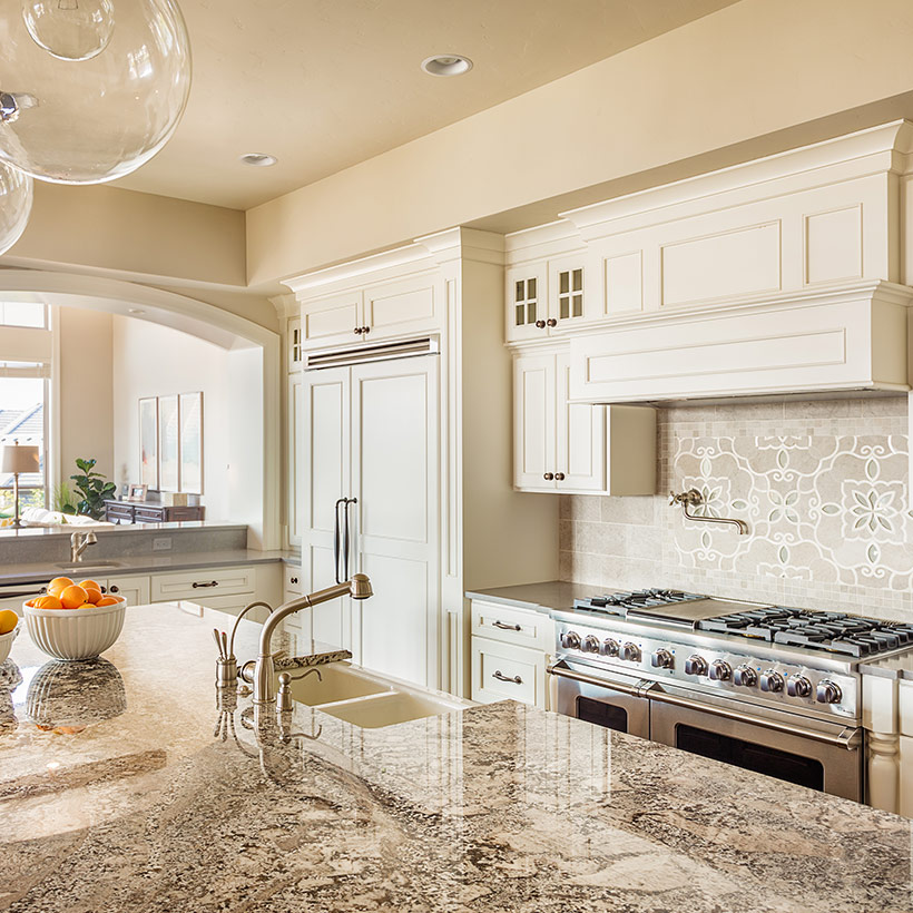 Smart kitchen renovation idea with a light colour palette and white cabinetry makes this kitchen look luxurious