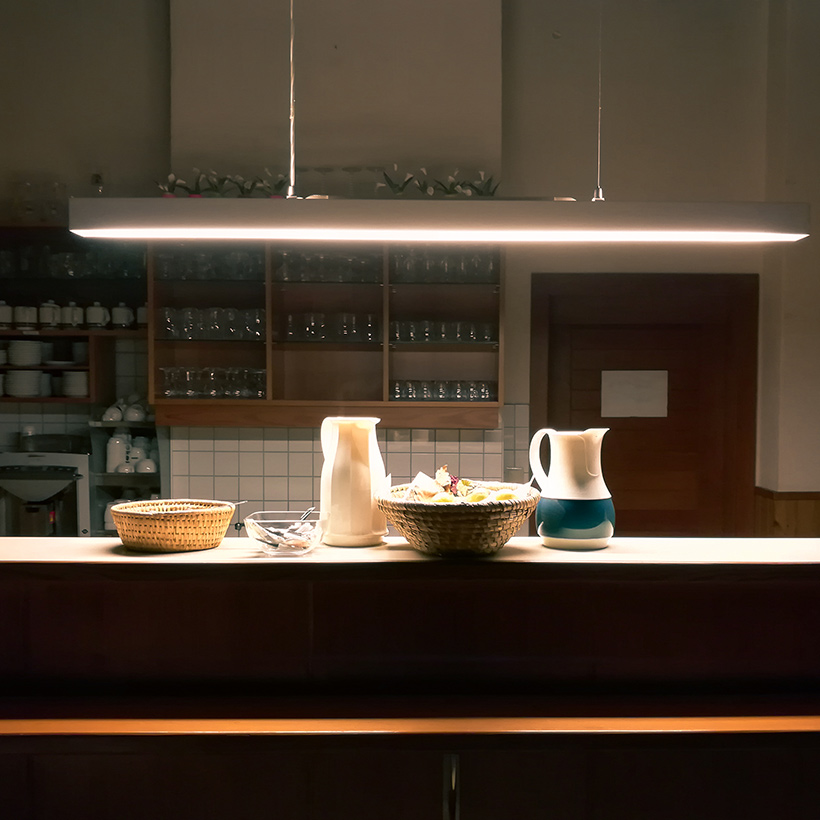 Redesign your kitchen with a low hanging lights and pendant lights create an illusion of a higher ceiling