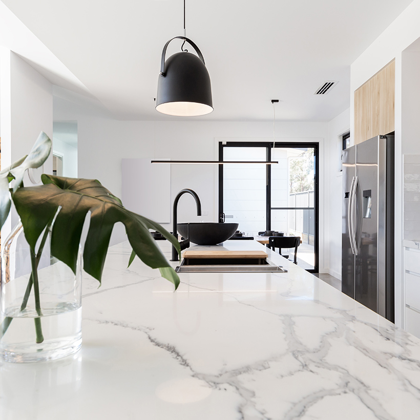 Use marble tiles to make a chic backsplash or use them to remodel a portion of the kitchen floor