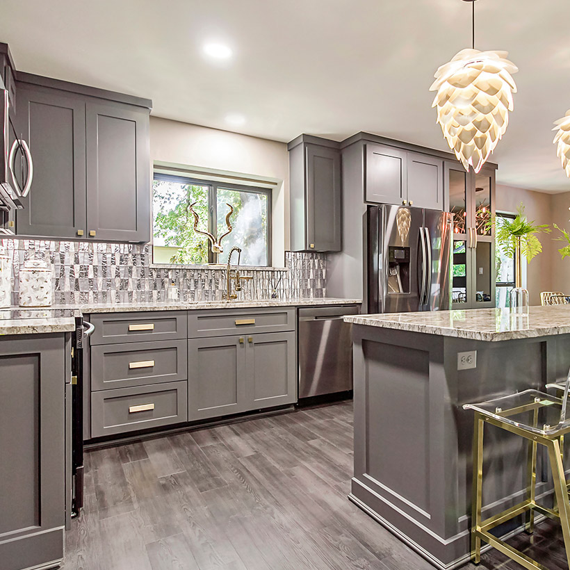 Great kitchen renovation idea with a beautiful grey cabinets with complementing decor