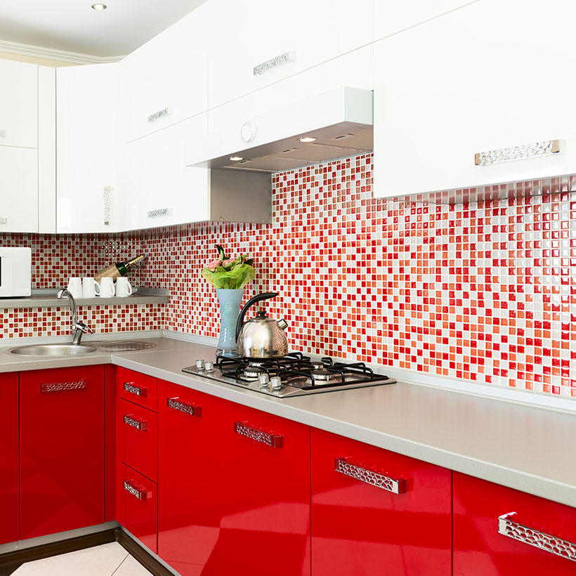 Kitchen cabinet color schemes with a bright and energetic colour palette with its tangy red and snow white