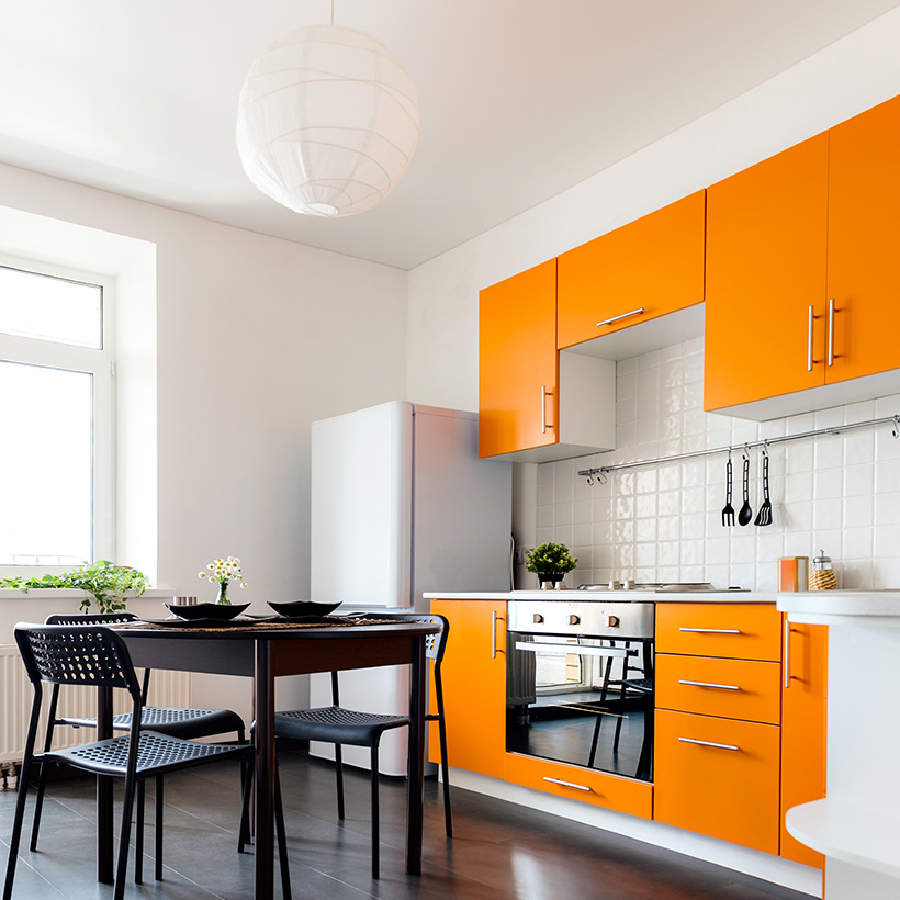 Latest kitchen cabinet colors are orange clubbed with the whipped cream white creates a fun yet warm space