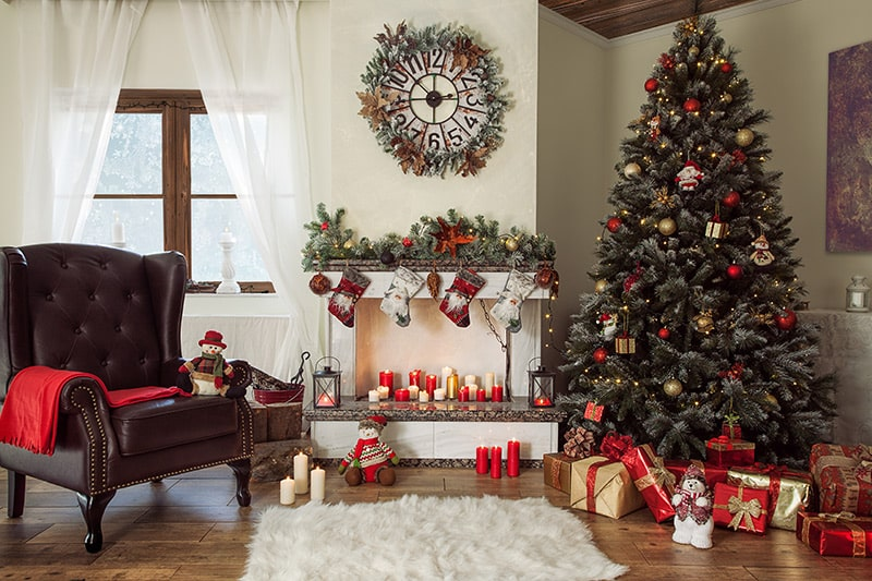 Interior home decoration for christmas, decorate your home using living room christmas decor ideas like wall decorations, center table decor, christmas tree images.
