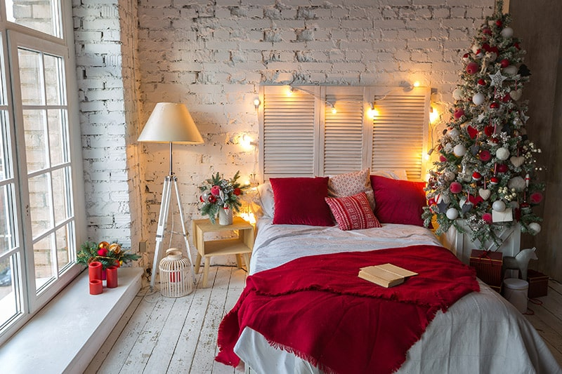 Christmas bedroom decor ideas using christmas decoration items, home decor, hanging decor, side table, table decor, bed interior designs, xmas light decorating ideas for bedroom.