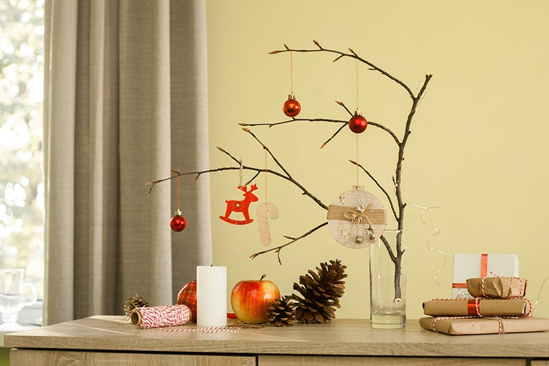 To decorate a handmade christmas tree use a simple and easy diy christmas decoration items, crafts, glass, real christmas tree branch, and get it ready in a low price that fits your budget.
