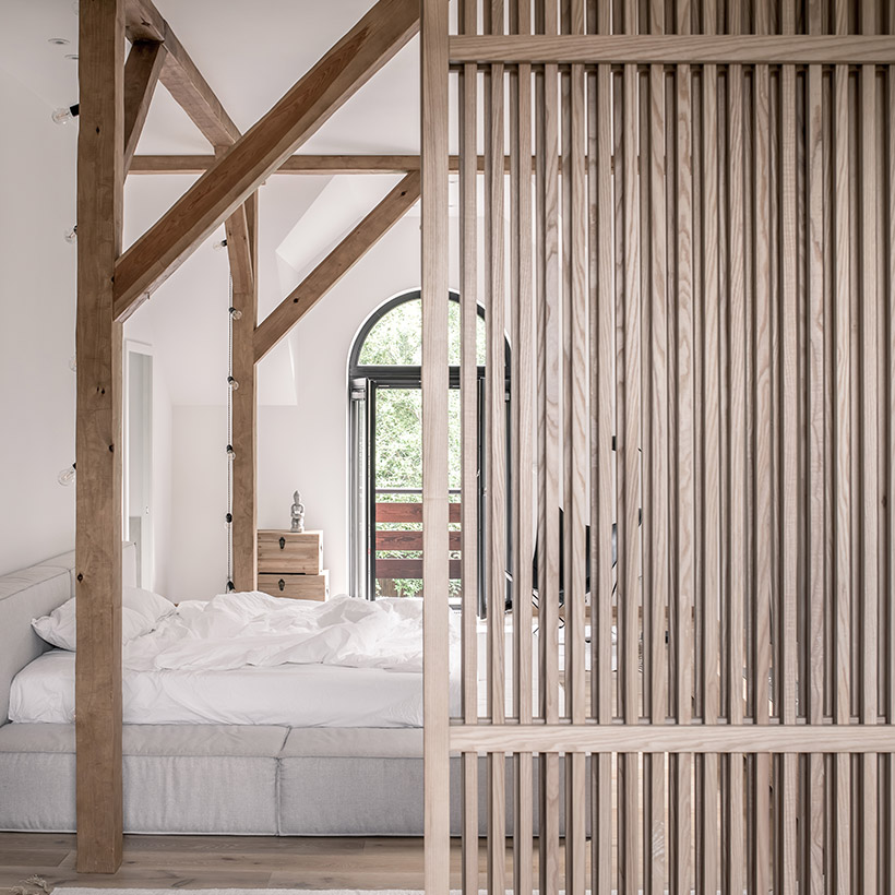 Partition design for living room and dining hall by wooden lattice and bed frames also made up of wood for living room and dining room partition