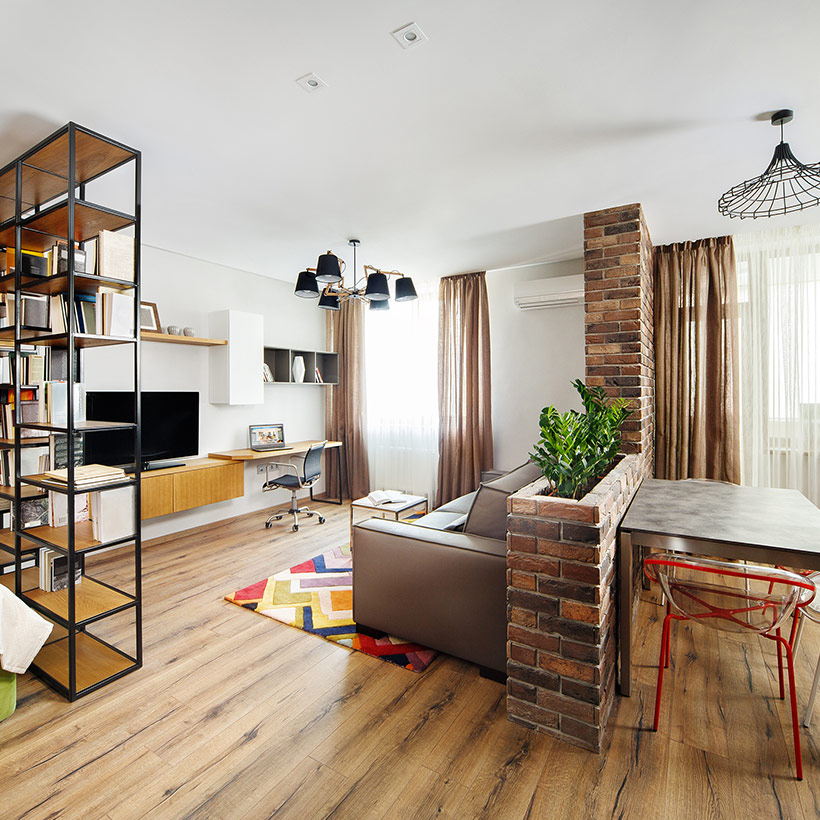 Living dining partition made up of wall made up of bricks which is a partition between living and dining
