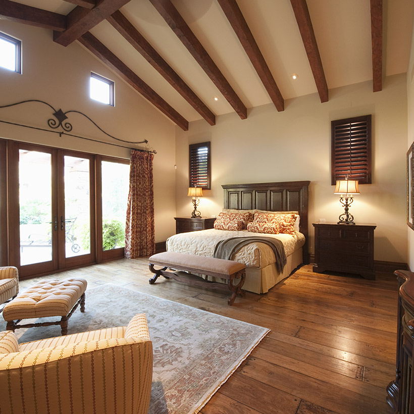 Master bedroom ideas for a room made up of a big wooden bed and big lamps on beside table in master bedroom interior design ideas