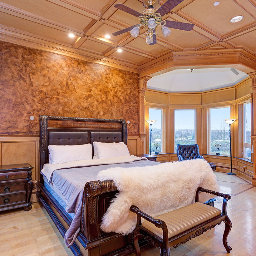 Master bedroom interior with a royal look and a circular lobby with glass windows in modern master bedroom