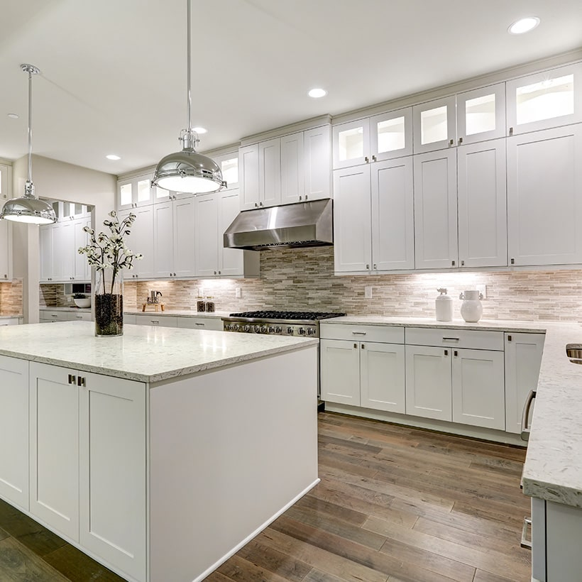 White kitchen island fits right into a white kitchen with stainless steel accents