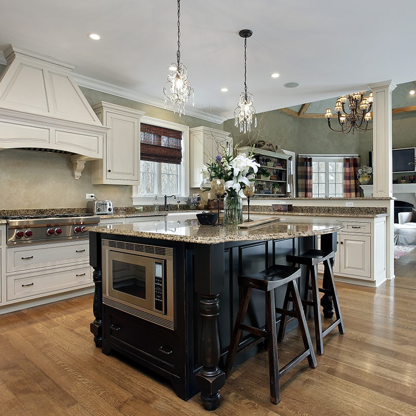 Kitchen island table with a countertop of the island juts out on both sides, providing table space