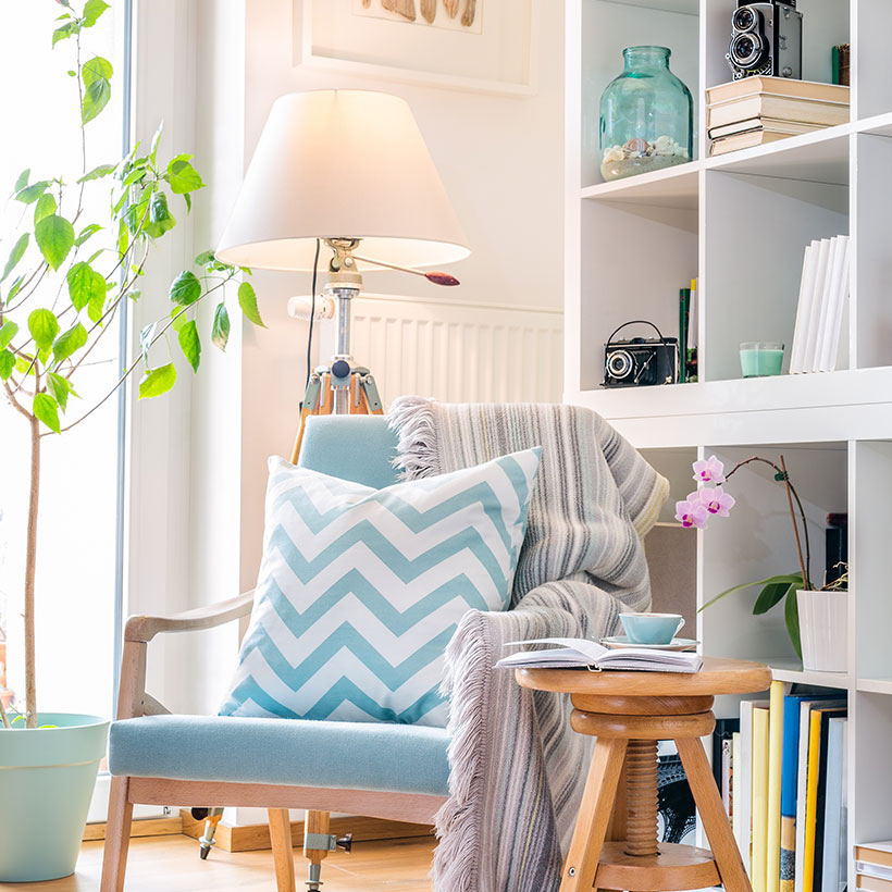 Master bedroom decor ideas with a beautiful wooden chair and shelve on the back in master bedroom wardrobe designs india