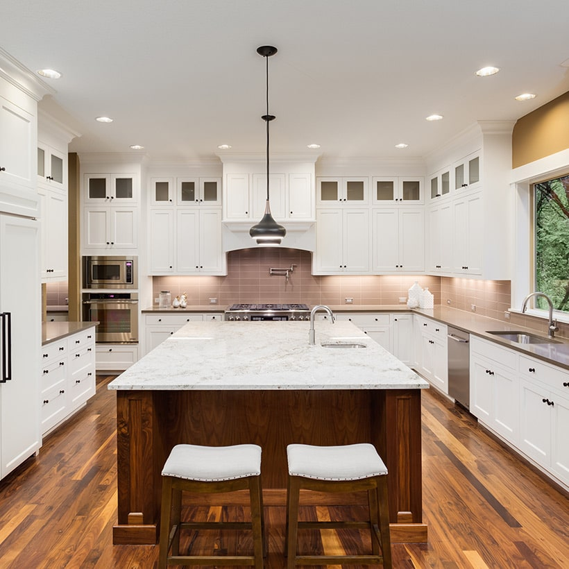 U shaped kitchen interior design has a large island placed at it center in line with the cabinetry