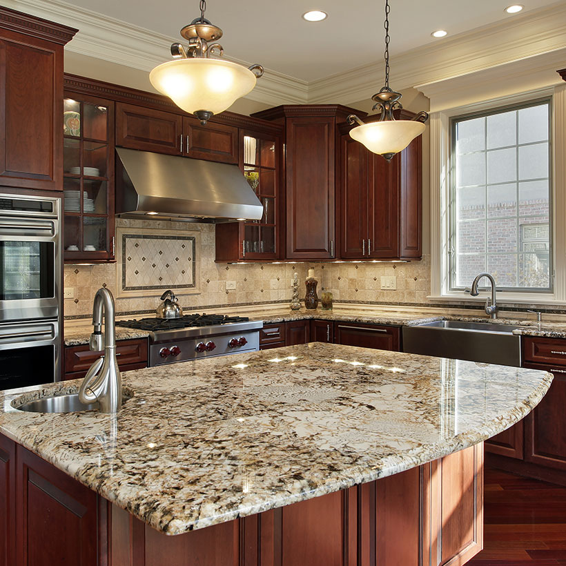 Classical l shaped kitchen interior design with island with the curved lines of the granite topped kitchen island