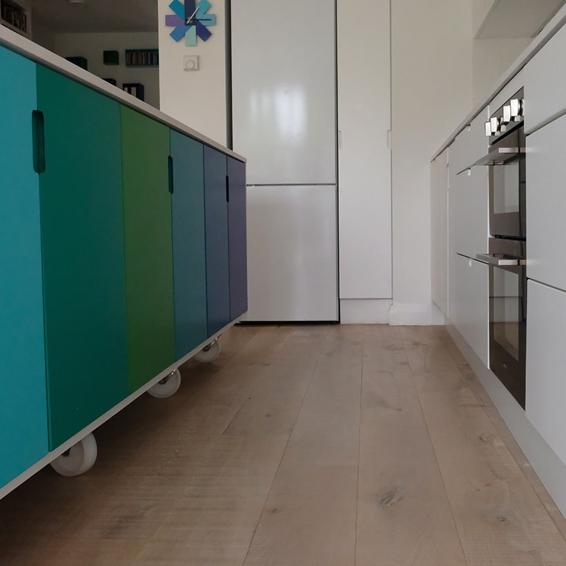 Kitchen island is finished retro style with the mdf doors painted such that the blues merging with the greens