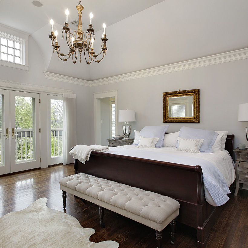Master bedroom design for a room with wooden flooring and white walls in master bedroom wall decor