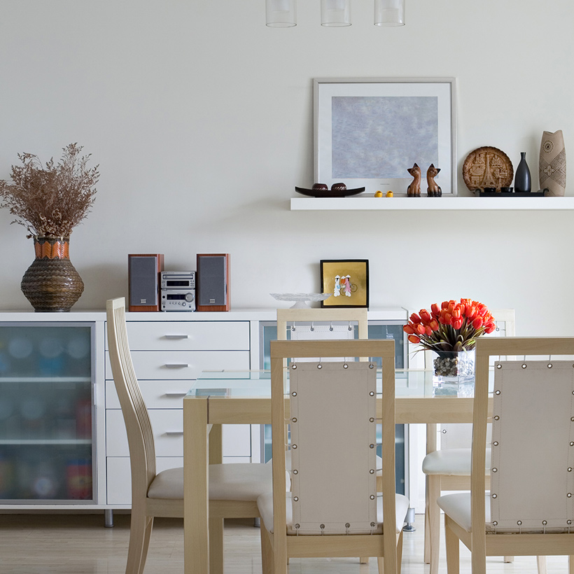 Tall dining storage cabinet with shelves on the sides and drawers in between for dining area storage cabinet