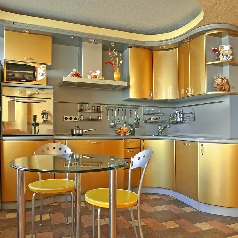 Metal kitchen cabinets with golden finish on upper and lower cabinets in curved style of kitchen cabinet doors