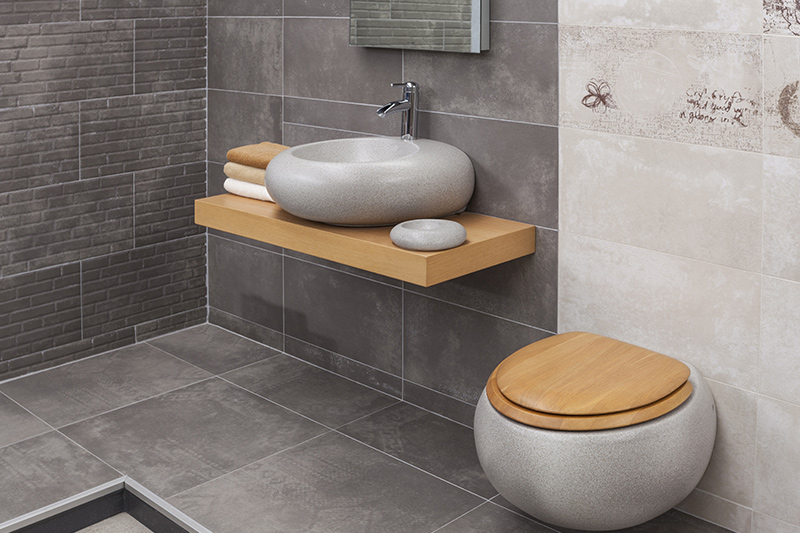 Luxury modern bathroom with pebble shape wash basin and commode in modern bathroom design ideas