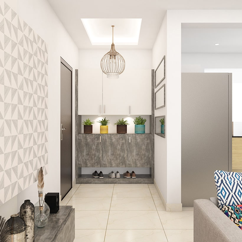 Entrance foyer area design with cupboard, wallpaper, decor, entryway furniture with storage and seating.