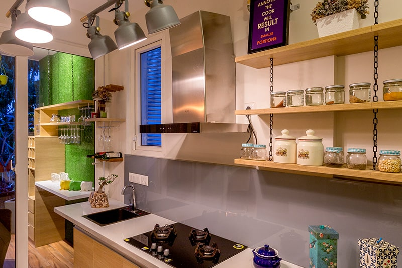 Hanging kitchen shelves bring a whimsical look to your kitchen by using material of wood, glass or metal