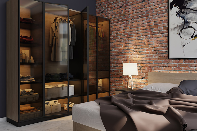 Modern bedroom wardrobe with glass shutters and iron corners with an industrial look in modern wardrobe door designs for small bedroom