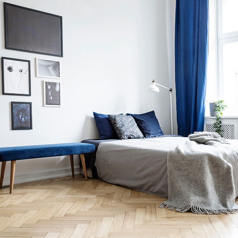 A fashionable statement with classic blue drapes and sheers for bedroom