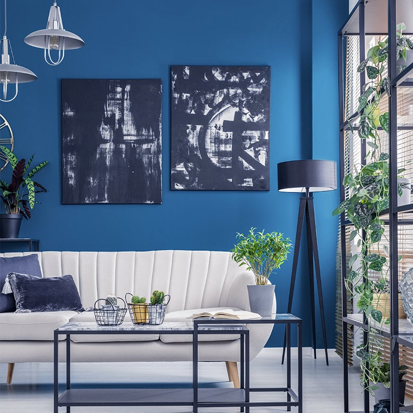 Living room wall artwork with the solid colour blue make our living room vibrant and fun