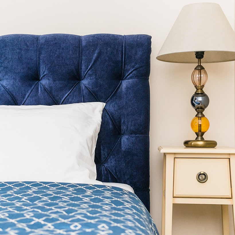 Revamp your bedroom with a pantone classic blue headboard, its looks royal