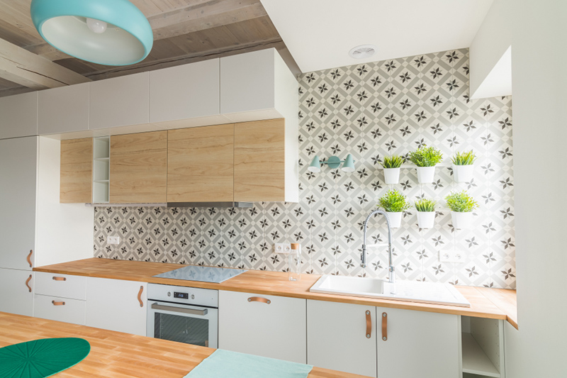Kitchen wallpaper with a flower printed on it with small flower baskets above the sink on kitchen backsplash wallpaper