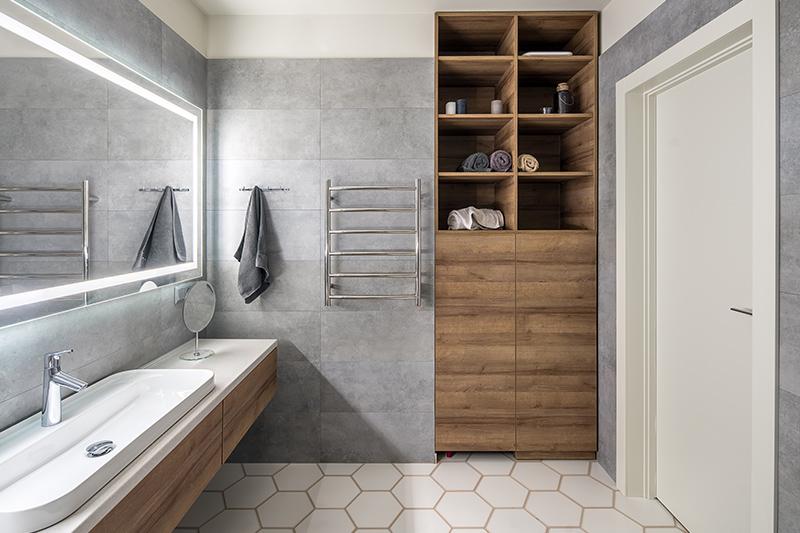 Bathroom floor tiles design with grey walls and hexagon shape tiles on the floor in white bathroom floor