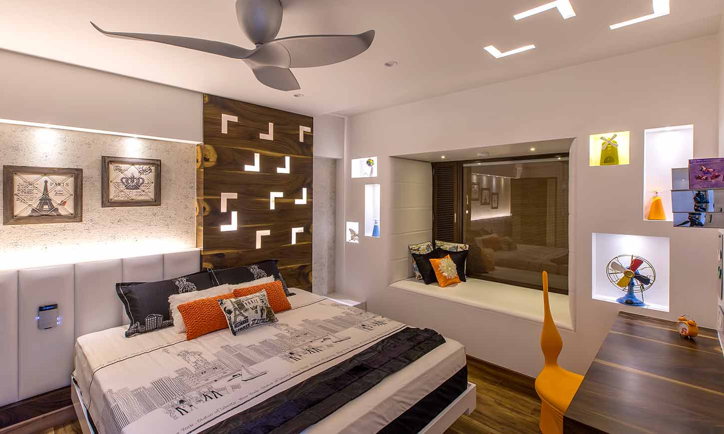 Bedroom designed by famous interior designers in bangalore where space looks like a personal gallery